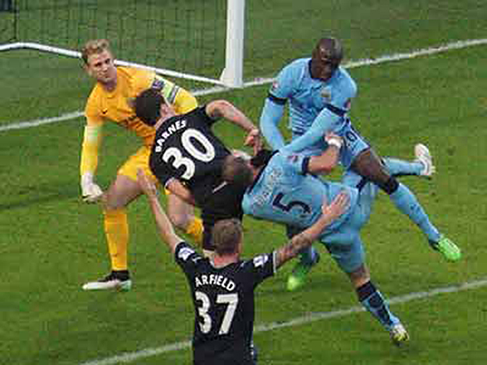 Zabaleta clash with Mangale (Photo by Richard Tucker)